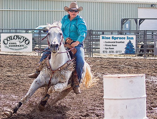 It is a real challenge to race a horse around barrels when the horses have to turn sharply in mud that is several inches deep. Above, Meeker's Lauren Urista takes the obstacles in stride in this ride as part of the barrel race held Sunday evening in the CPRA-sanctioned rodeo at the Rio Blanco County Fairgrounds in Meeker as part of Range Call.