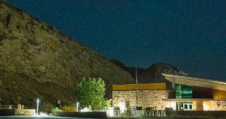 A dark, starry sky fills the night above the Quarry Visitor Center in Dinosaur National Monument, which is celebrating the dark clear skies this week and weekend.