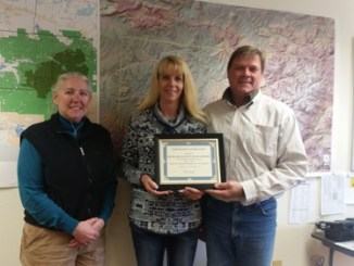 "Rio Blanco County Road and Bridge received a Certificate of Recognition from Community Counts Colorado (CCC) Nov. 9 for their service and support of Community Counts from 2013–2016. ""They have been instrumental with helping CCC with the purchase and installation of 30 CCC signs on county roads and truck routes from Rangely to Meeker (Piceance Creek and Strawberry), along with working with our organization to solve issues that might require road and bridges' help,"" said CCC Director Nita Smith. Community Counts Colorado (CCC) is a non-profit organization established in 2007 to facilitate open communication between the community and the energy and extraction industries.  ""We operate in Garfield, Mesa and Rio Blanco counties,"" Smith said. Pictured are Dave Morlan, director of RBC Road and Bridge (right), Crystal Reinhard, sign maintenance technician (left), and Nita Smith (center).  courtesy photo"