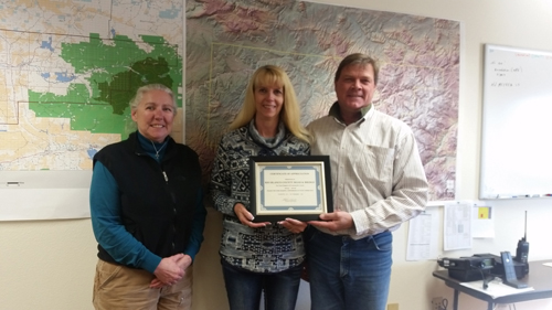 """Rio Blanco County Road and Bridge received a Certificate of Recognition from Community Counts Colorado (CCC) Nov. 9 for their service and support of Community Counts from 2013–2016. """"They have been instrumental with helping CCC with the purchase and installation of 30 CCC signs on county roads and truck routes from Rangely to Meeker (Piceance Creek and Strawberry), along with working with our organization to solve issues that might require road and bridges' help,"""" said CCC Director Nita Smith. Community Counts Colorado (CCC) is a non-profit organization established in 2007 to facilitate open communication between the community and the energy and extraction industries.  """"We operate in Garfield, Mesa and Rio Blanco counties,"""" Smith said. Pictured are Dave Morlan, director of RBC Road and Bridge (right), Crystal Reinhard, sign maintenance technician (left), and Nita Smith (center).  courtesy photo"""
