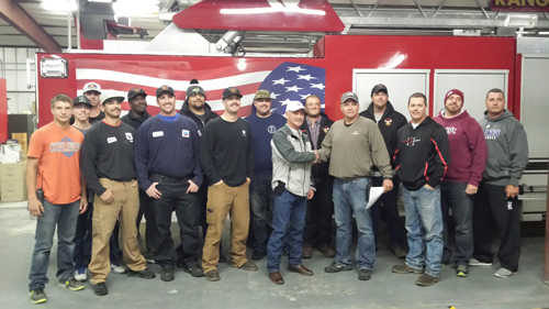 Chevron donated $4,000 to the Rangely Rural Fire Protection District to help increase their capacity to build a rural firefighting unit. From left to right, Tristan Moore, Daiman Getler, Scott Ellis, Joey Medina, Carlton Quinnie, Kyle Hixson, Bo Lucas, Darrel Clymer, Kindal Cushman, Troy Waldner, Cody Kinney, Andy Shaffer, Brent Bland, Clint Hunter, Jasper Whiston and Gary Denny. Courtesy Photo