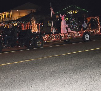 """This float gave a nod to the classic movie """"A Christmas Story,"""" which was the theme for this year's Christmasfest celebration during the parade of lights. RENÉ HARDEN photo"""