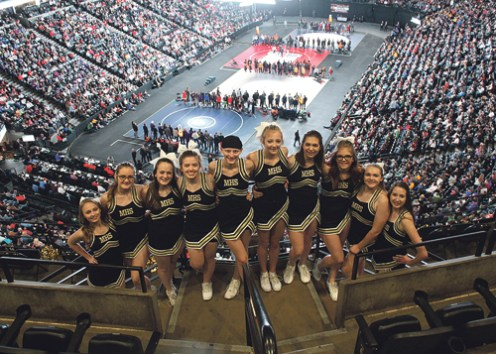 "The Rio Blanco County Cheerleading squad, pictured during the Parade of Champions. The cheerleaders, who perform tirelessly at every game, meet and the ""Big Show"" are coached by Becky Ridings."