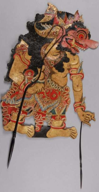 The colours and designs of Javanese shadow puppets are all clues to help identify the character. Here, the reddish-pink colour of Kumbakarna's face is an indication of his ruthlessness, while the tusks in the corner of his mouth suggest that he is a giant or a monster. However, he also has positive characteristics, such as his loyalty to his brother, which are brought out in the performance. Kumbakarna is the giant brother of Dasamuka, called Rahwana in the Indian version of the tale of the Ramayana. He is Rama's enemy: having captured Rama's wife, Sita, Dasamuka faces the onslaught of Rama aided by Hanuman and his army. Although Kumbakarna advises him to free Sita, Dasamuka refuses and the two brothers die in the battle against Rama and his allies. The earliest references to shadow puppets in Java are by court poets in the eleventh century. Performances today are very popular and stories are drawn partly from Javanese sources and partly from Indian epics (the Mahabharata and Ramayana). It is a form of entertainment most often sponsored to celebrate a particular event, such as marriage, or as part of ceremonies. The puppeteer is not simply a performer, but also a ritual specialist because of the beneficial influence that the performance of shadow plays is believed to have on the well-being of the community. Credit: The British Museum
