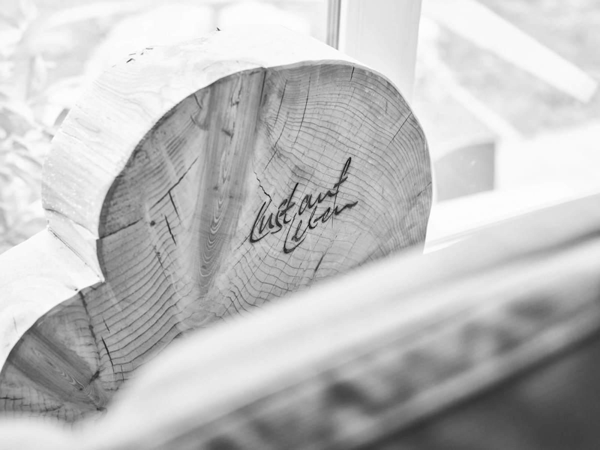 """Kunst aus Holz mit Aufschrift """"Lust auf Leben"""""""