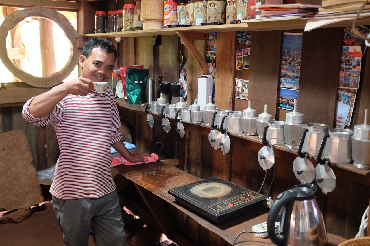 Mr. Vieng explaining telling us all about growing coffee beans and peanuts (Bolaven Plateau, Laos)