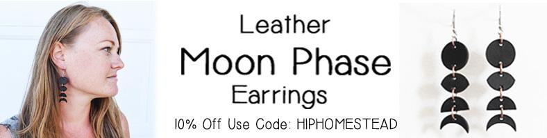woman wearing black leather moon phase earrings