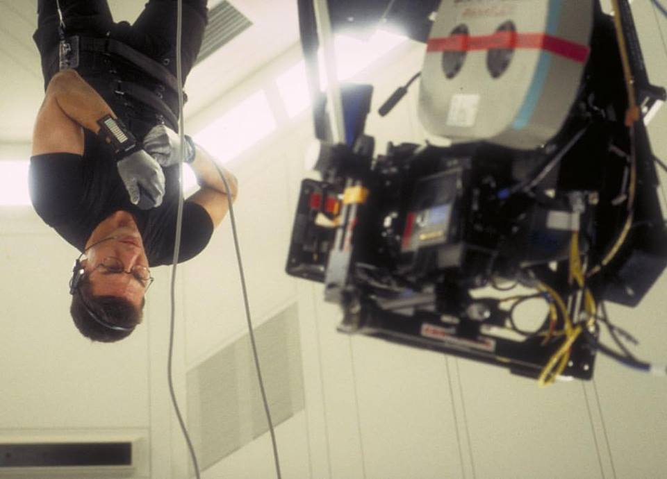 Tom Cruise gives everything into the game. This photo, shooting for 'Mission: Impossible' (1996). Directed by Brian De Palma