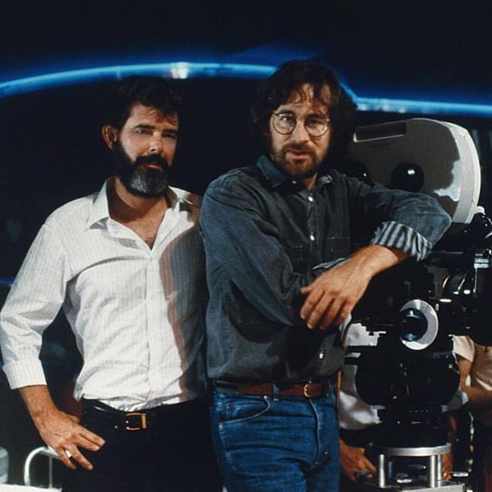 George Lucas and Steven Spielberg on the set of 'Indiana Jones and the Temple of Doom' (1984) shooting the opening scene