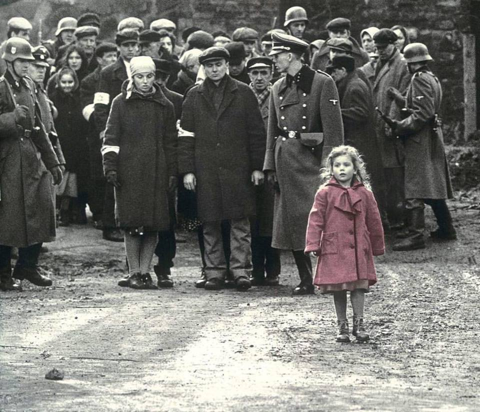 "'Schindler's List' (1993): ""Other than Shabbat Candles, the little girl in red also has a great social significance. Her red coat suggests the ""red flag"" the jews waved at the Allied powers during World War II as a cry for help. The little girl walks through the violence of the evacuation as if she can't see it, ignoring the carnage around her. Her oblivion mirrors the inaction of the Allied Powers in helping to save the Jews. Schindler later spots her in a pile of exhumed bodies, and her death simbolizes the death of innocence. Iconic piece of art, transcends the dimensions of cinema"