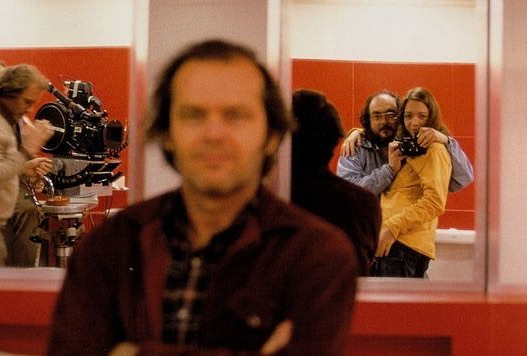 Stanley Kubrick and his daughter taking a photo of Jack Nicholson in the set of