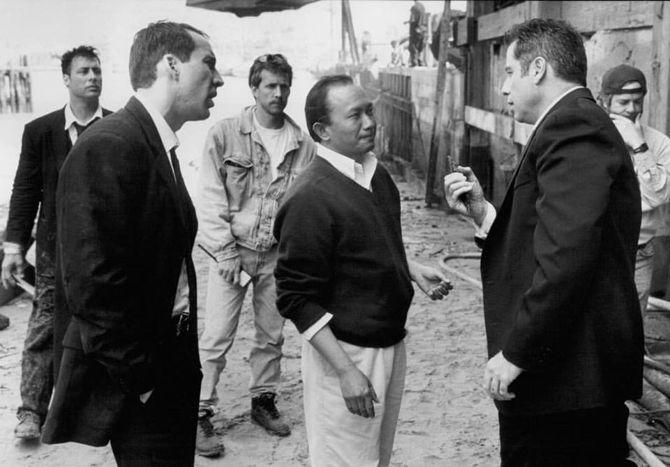 Nicolas Cage, John Travolta and director John Woo behind the scenes of 'Face/Off' (1997)
