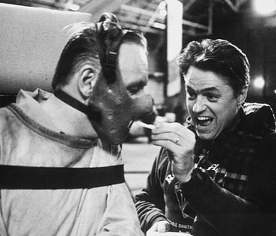 Director Jonathan Demme gives a snack to Sir Anthony Hopkins on the set of 'Silence of the Lambs' (1991). Both of them won an Academy Award for Best director and best actor on a leading role.