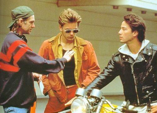Director Gus Van Sant, River Phoenix and Keanu Reeves on the set of
