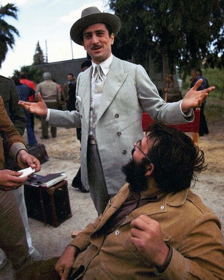 Robert De Niro behind the scenes with Francis Ford Coppola in 'The Godfather: Part II' (1974). Movie he won his first Academy Award for best actor in a supporting role.