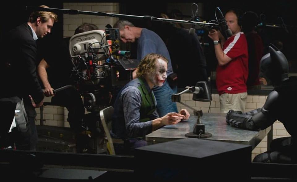 Christopher Nolan, Heath Ledger and Christian Bale behind the scenes of 'The Dark Knight' (2008)
