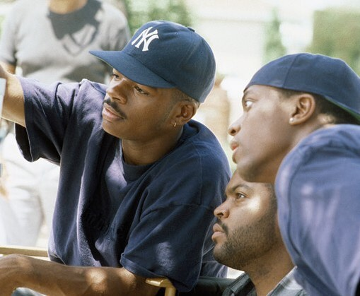 F. Gary Gray, Ice Cube and Chris Tucker behind the scenes of 'Friday' (1995)