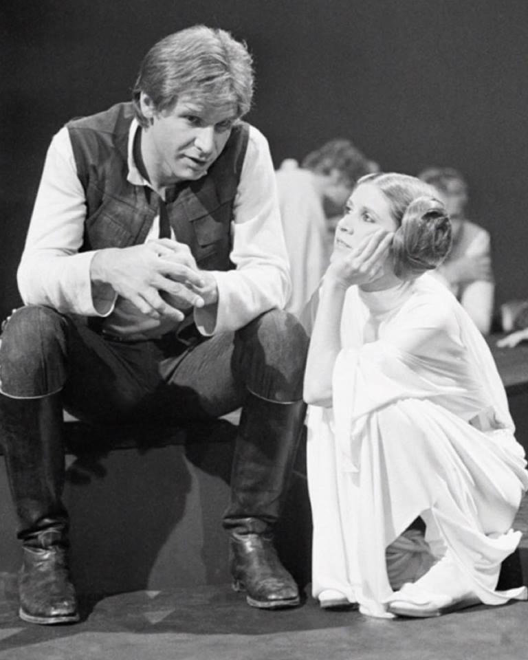 Behind the scenes: Harrison Ford and Carrie Fisher between takes on the set of Star Wars (1977)