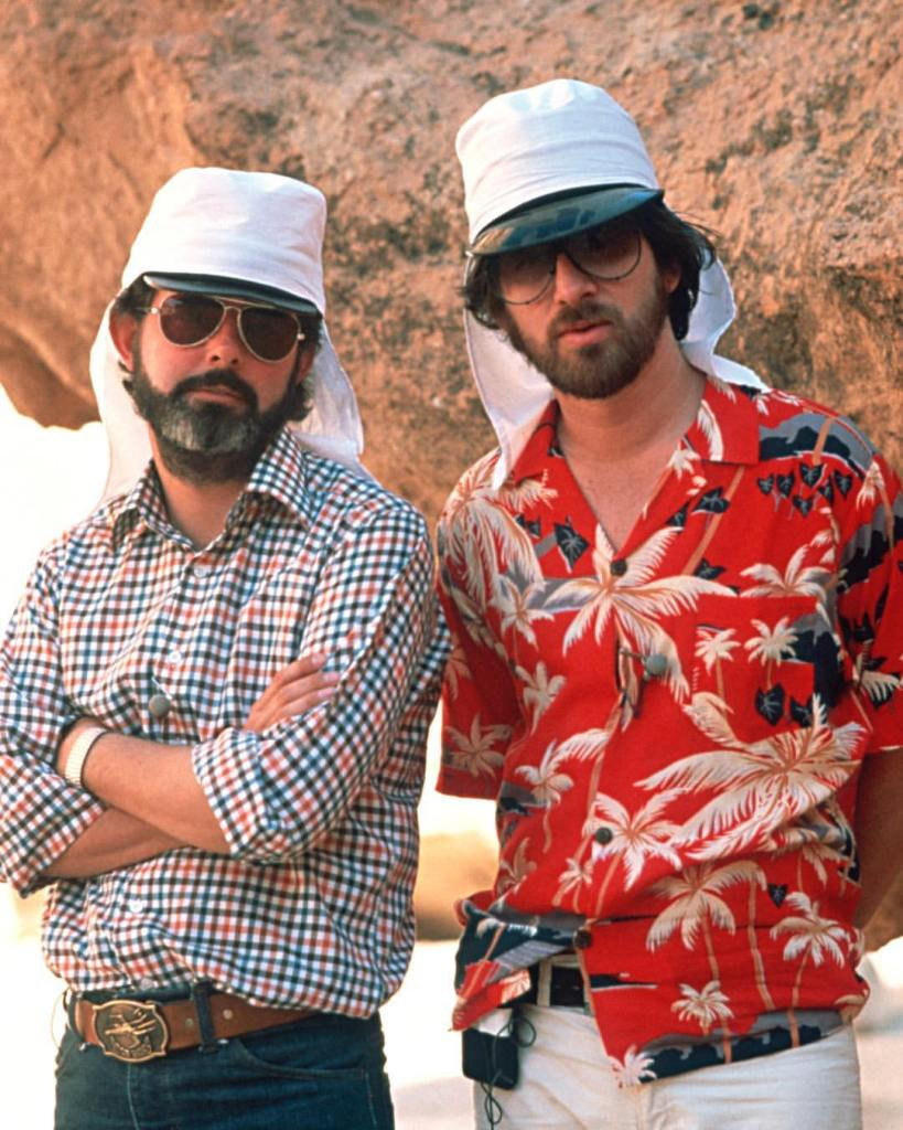 Behind the scenes photo of Steven Spielberg & George Lucas on the set of 'Raiders of the Lost Ark' (1981)