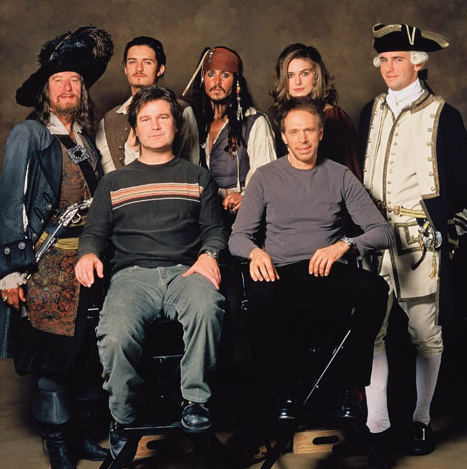 The cast of 'Pirates of the Caribbean: The Curse of the Black Pearl' (2003) Geoffrey Rush, Orlando Bloom, Johnny Depp, Keira Knightley, Jack Davenport with the producer Jerry Bruckheimer and director Gore Verbinski