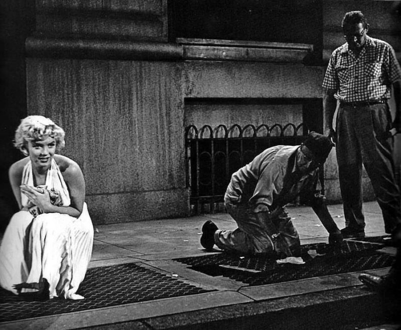 History in the making: Marilyn Monroe waiting for crew to prepare the set for the famous 'That silly little dress' scene in 'The Seven Years Itch' (1955)