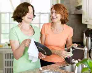 two old and young women wiping the dishes using best flour sack dish towels