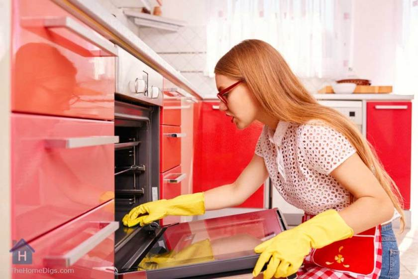 a young girl cleaning the oven red decor kitchen