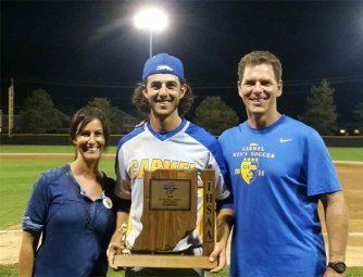Tommy, his mother (Susie), and his father (Juergen) at Carmel High School. (The Sommer family)