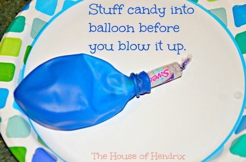 Stuff candy into Balloon. kids have to pop it for their treat