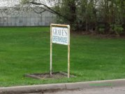 The unassuming sign for Graye's greenhouse
