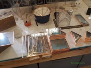 Pieces of glass wrapped with copper ready to be made into terrariums