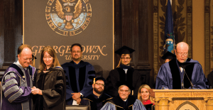 Georgetown University Law Center Dean William Treanor presented 11 newly tenured faculty members and six new full professors at a ceremony in Gaston Hall on Tuesday. ALEXANDER BROWN/THE HOYA