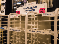 ALEXANDER BROWN/THE HOYA Collegiate Readership stands emptied by professors and graduate students  by midday factored into GUSA Fin/App's decision to cut the program.
