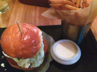 JULIA MCCRIMLISK/THE HOYA  Penn Commons serves classic American fare with an upscale twist. The Haight-Ashbury Burger is a crisp falafel burger with pickled vegetables, feta cheese and cilantro, accompanied by yummy fries.