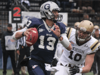 ERIN NAPIER/THE HOYA  Junior quarterback Kyle Nolan threw and rushed for a touchdown in Saturday's 27-19 loss to Lehigh. He has nine total scores this year.