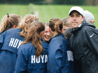 GUHOYAS Michael Smith, head coach of the No. 2 women's cross-country team, was named the Big East Coach of the Year on Friday.