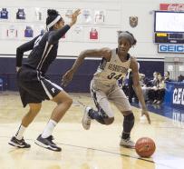 JULIA HENNRIKUS / THE HOYA Freshman guard Dorothy Adomako dribbled around a defender in a 69-61 win against Providence