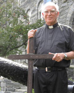 COURTESY FR. PAT ROGERS, S.J. The Dahlgren Chapel cross, which was discovered in a storage space in Healy Hall by Fr. G. Ronald Murphy, S.J. (pictured) in 1989, will be featured at Pope Francis' first mass next Wednesday.