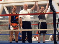 COURTESY GEORGETOWN CLUB BOXING Junior Sinead Schenk, right, won a national boxing title after moving up a weight class to defeat her opponent in the 132-novice bracket. Schenk has now earned two national titles.