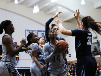 GU HOYAS | Graduate student guard Dorothy Adomako, center, led the Georgetown women's basketball team to victory against Villanova.
