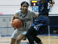 THE HOYA\Kirk Zieser | Senior guard Dionna White drives the ball down the court looking for a shot.