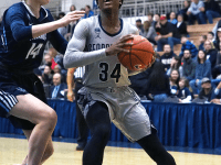 KIRK ZIESER/THE HOYA| Graduate guard Dorothy Adomako looks up for a shot in the paint against a Villanova defender.