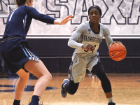 KIRK ZIESER/THE HOYA | Graduate guard Dorothy Adomako drives to the basket in a home game for the Hoyas.