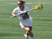 MARGARET FOUBERG/THE HOYA | Junior midfielder Natalia Lynch takes the ball down field during the matchup against Denver on Cooper Field. Lynch contributed one assist and two shots on goal in the loss.