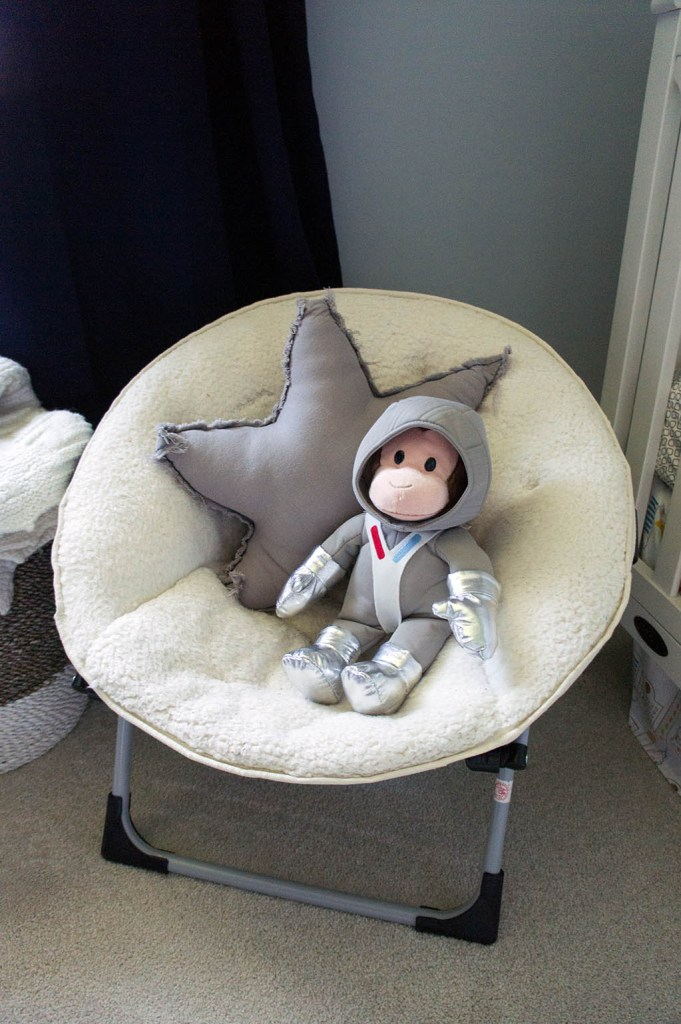 Baby Andrew's space cowboy themed nursery. Astronaut monkey and moon chair.