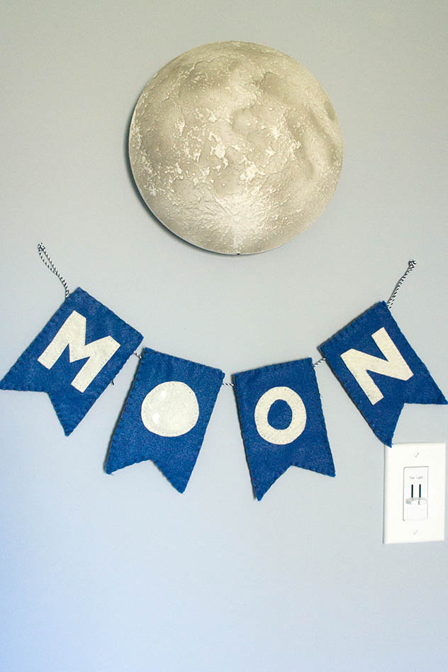 Baby Andrew's space cowboy themed nursery. Nursery moon banner and light up moon.
