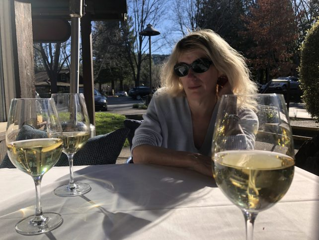 Woman sitting at cafe table with three glasses of wine. Caption, I was better off alone.
