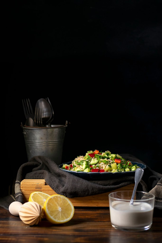 Healthy brown rice salad with lemon – tahini dressing