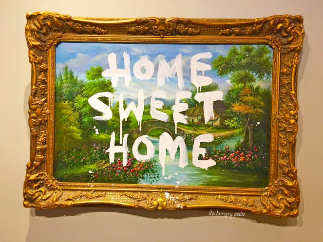 Home Sweet Home - Banksy spray-painted on top of another artist's work