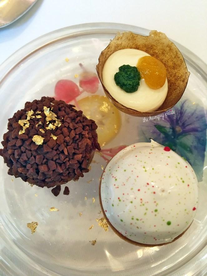 Pre-dessert palate cleansers: raspberry meringue tart, tarragon passion fruit tart, chocolate tart